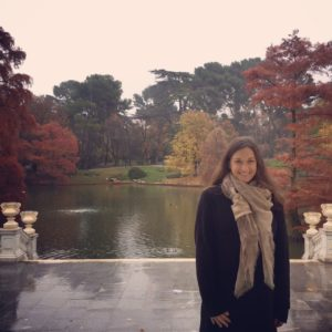 Rachel in the early morning rain of El Retiro Park.