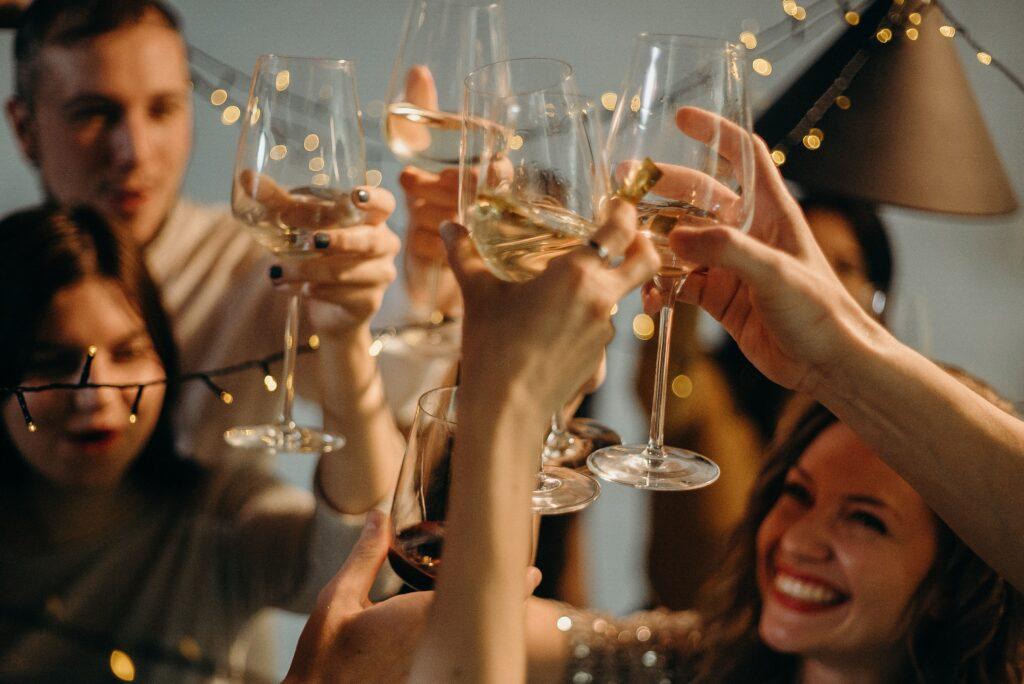 people drinking cheering wine