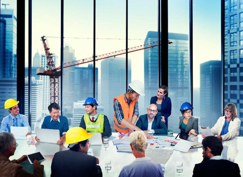 construction workers in boardroom cm