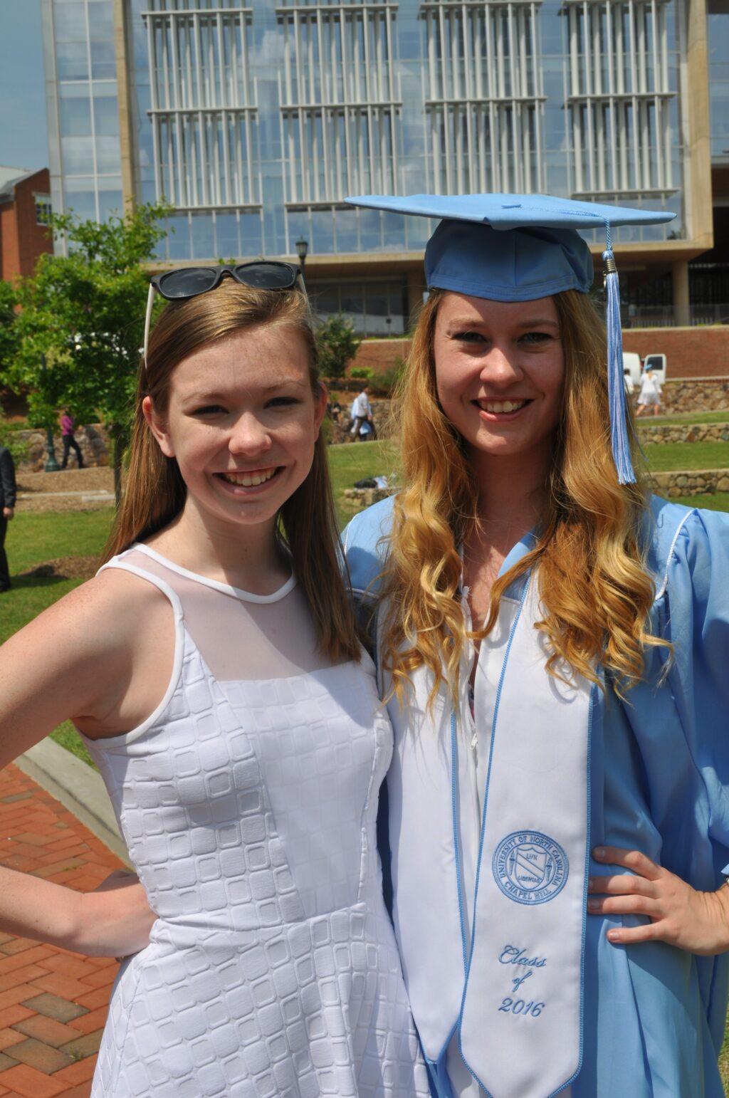 Sisters at UNC graduation