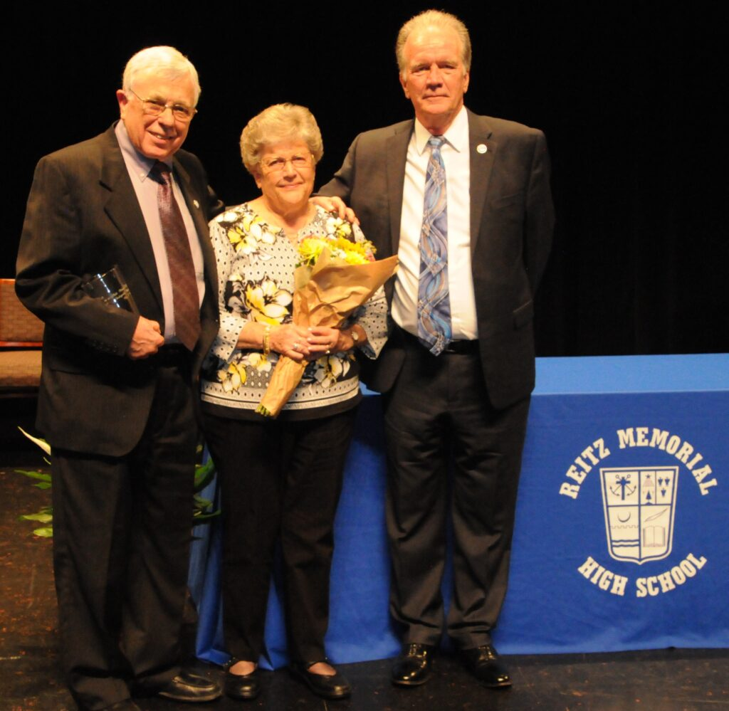 Memorial President John Browning, right, awarded the Distinguished Service Award to James and Janice Hummel for their more than 60 years of support to the high school.