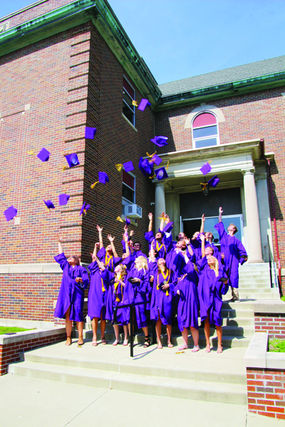 Members of the Rivet High School Class of 2019 toss the caps in the air after the May 18 Commencement Ceremony at the high school.