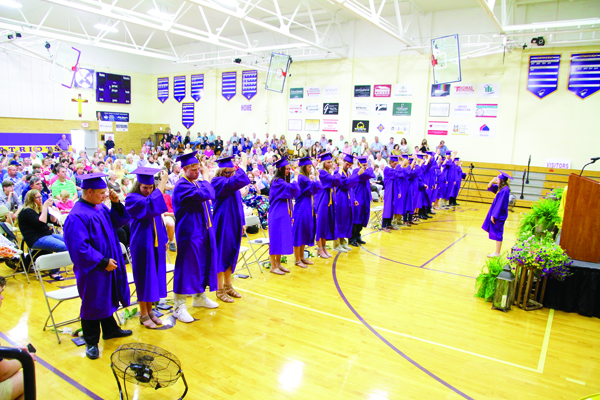 Class of 2019 President Savannah Cook leads her Rivet High School classmates as they move their tassels to signify their status as graduates.