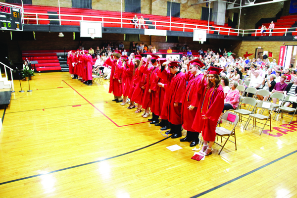 Members of Washington Catholic's Class of 2019 move their tassels to acknowledge their status as graduates.