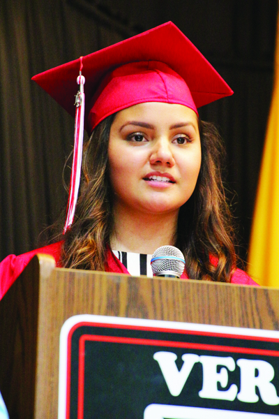 Washington Catholic 2019 Valedictorian Paloma Atilano speaks during Commencement. Atilano, who is bilingual, delivered her remarks in English and Spanish.