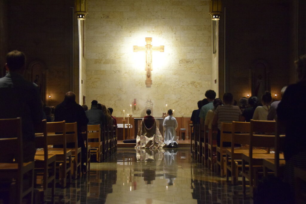 All kneel before the Blessed Sacrament during the Holy Hour in the Thomas Aquinas Chapel on Day 4 of One Bread One Cup. Photo courtesy of St. Meinrad Archabbey