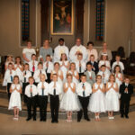 Christ the King Parish, St. Ferdinand Church, Ferdinand Christ the King Parish celebrated First Communion at St. Ferdinand Church in Ferdinand on May 12. Shown are Addison Evitts, front row left, Jace Brockman, Carter Becher, Trey Steckler, Ellie Meunier, Kayden Fleck, Madelyn Ferguson, Haley Jahn, Xavier Berg, Miles Rea, second row left, Reid Mehringer, Isaac Martin, Makenna Morrison, Adrian Reckelhoff, Nathan Reinke, Gavin Schipp, Addison Hochgesang, Third Row - Piper Laake, third row left, Preslie Jochem, Jayden Gray, Mason Winkler, Brooklyn Fleig, Caleb Sickbert, Braxton Schaefer, Tenley Blessinger, Ian Kemper, Back Row- Catechist Kateri Buechler, fourth row left, Catechist Erika Meunier, catechist; Administrator Father Anthony Govind, Catechist Dolores Lueken and Parish Catechetical Leader Debbie. Catechist Linder Weyer is not pictured. Submitted photo