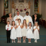 Christ the King Parish, St. Henry Church, St. Henry Christ the King Parish celebrated First Communion at St. Henry Church in St. Henry on May 12. Shown are at 7:30 Mass.  First Row - Will Roesner, first row left, Kate Prior, Isabella Nall, Ainsley Quinn, Paige Reihle, Josie Buening. Second Row – Parish Catechetical Leader Debbie Schmitt, second row left,  Deacon James King, Administrator Father Anthony Govind and Catechist Sue Schwinghamer. Submitted photo