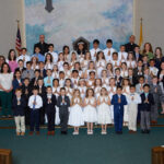 Holy Rosary Parish, Evansville Holy Rosary Parish in Evansville celebrated First Communion on April 28 and May 5. Shown are Rudy McFall, first row left, Aven Wilber, Meyer Hermann, Jax Pickerill, Jalyn Bueltel, Everly Lindy, Ady Grace Baker, Juan Felipe Pulgárin Rojas, Larri Roblero Masariegos, Matthew Mahinay, Teddy DeVries, second row left, Silas Melchiors, Ethel Villasana, Chloe Groninger, Kali Smith, Anna Hogue, Emily Adams, Ella Clare Engbers, Ricardo Montanez, Evan Brunkhart, Ivette Hung, third row left, Alex Aurs, Coulter Cooley, Levi Biggs, Alyson Hernandez , Victoria Villasana, Nicolle Cardenas, Chloe Jones, Will Engelbrecht, Daniel Hillenbrand, Marcus Gatz, Jodi Wilber, Patricia Velasco, fourth row left, Carter Raben, Mack Williams, Fabrizio Ramírez, Hilary Ray, Paige Wilson, Lila Markle, Stella Raben, Kensley Shields, Emma Wininger, Gabrio Hung, Bryan Morales, Courtney Foster, fifth row left, Ainsley Bagbey, Jillian Hinton, Kyrie Easley, Norah Havill, Emi Garau, Margo Martin, Lissette Morales, Olivia Raisor, Cash Elliott, Natalie Neisen, Maximilian Razor, sixth row left, Jonathan Laboy, Samuel Razor, Ashly Roblero, Yaretzi Gomez, Allen Ramírez Perez, Bradley Ramírez Perez, Jonny Mosqueda Ayala, Jacob Hinton, Kim Engbers, Pastor Father Bernie Etienne, seventh row left, and Parochial Vicar Father Fr. Homero Rodríguez. Submitted photo