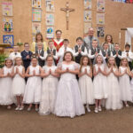St. Joseph Parish, Princeton St. Joseph Parish in Princeton celebrated First Communion on May 5. Shown are Keirsten Malone, first tow left, Rylie Arnold, Daisee Keeker, Halle Powers, Dalaney Schatz, Dally Halbig, Kaprice Tooley, Bailey Seibert, Sydney Walker, Zophia Rich, Michelle Nelson, Trevor Mayer, second row left, Cole Winkler, Maddux Payne, Connor Fox, Charles Pea, Karter Summerville, Caleb Fox, Marshall Watt, Baron Ravellette, Yves Bonny, Second Grade Faith Formation Catechist Debbie Bateman, third row left, Pastor Father Brian Emmick, St. Joseph School Principal Dan Gilbert and St. Joseph School Second Grade Teacher Brittany Weiss. Submitted photo