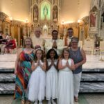 Sts. Mary and John Parish, Evansville Sts. Mary and John Parish in Evansville celebrated First Communion on May 26. Shown are Gianna Tretter, front row left, Kajua Johnson, Ella Russell, Kim Brown, second row left, Deacon Dennis Russell, Administrator Father Benny Alikandayil Chacko, Deacon Tom Kempf and Lee Ann Kipta. Submitted photo