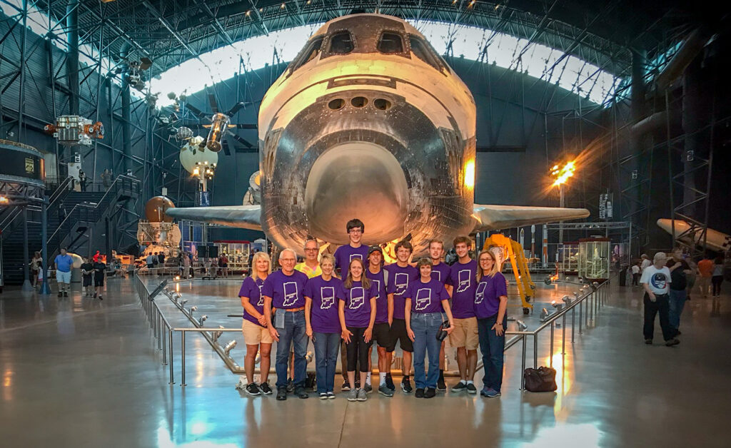 Rivet students and the adults accompanying them visited the Smithsonian National Air and Space Museum during their trip to Washington, D.C. Standing in front of a retired NASA space shuttle are Brenda Donovan, left, Joe Cook, Mike Freeman, Janet Cook, Savannah Cook, Grant Freeman (standing behind Savannah), James Hancock, Cedric Schleiss, coach Beverly Adams, Noah Donovan, Jack Whitsett and Tammy Catt. Submitted photo