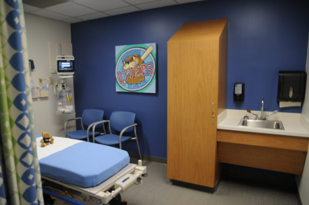The newly designed Peyton Manning Children's Hospital Emergency Room for Children at St. Vincent Evansville offers specialized pediatric emergency care closer to home for Tri-State families, and it includes seven private treatment rooms and specialized equipment. Each room displays an Evansville-themed painting.