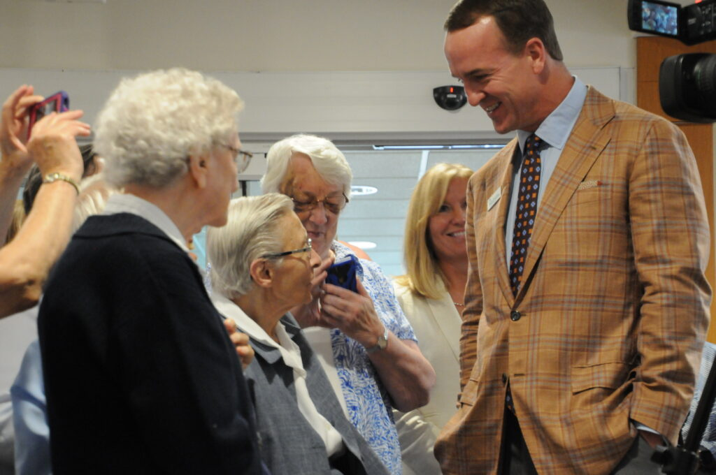 Former Indianapolis Colts quarterback Peyton Manning chats with Daughter of Charity Sister Mary John Tintea after a press conference on Aug. 14 announcing the Peyton Manning Children's Hospital brand expansion and new emergency room for kids at St. Vincent Evansville. The Message photos by Megan Erbacher