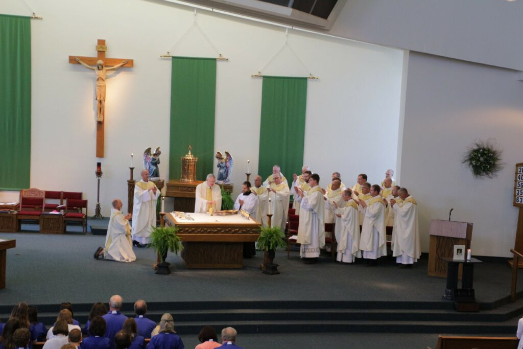Bishop Joseph M. Siegel prays the Eucharistic Prayer during the annual Back-to-School Mass on Aug. 2, 19 priests of the diocese concelebrated Mass with the bishop and Deacon Joe Siewers assisted.