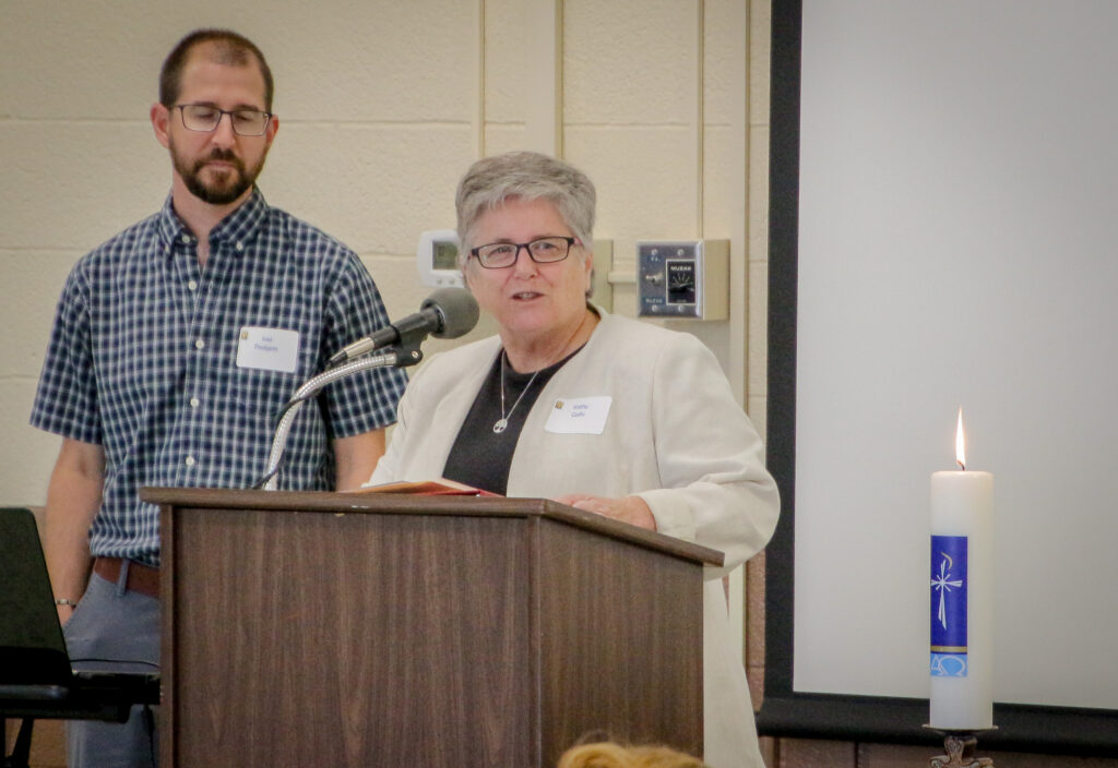 "Joel Padgett, left Parich Catechetical Leader at St. John the evangelist Parish in Daylight, listens as Diocesan Director of Catechesis Kathy Gallo welcomes attendees to the 2019 Formation Day Aug. 24 at the Diocese of Evansville Catholic Center. Gallo urged attendees to approach the day – and their ministries – with this question in mind: ""How will what I do put people in touch with Jesus Christ?"" The Message photos by Tim Lilley"