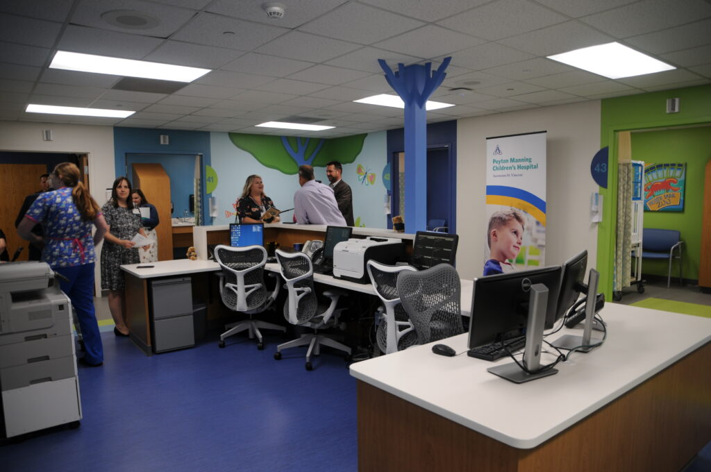 The nurse station of the new Peyton Manning Children's Hospital Emergency Room for Children at St. Vincent Evansville, with doors to the seven private treatment rooms surrounding it.