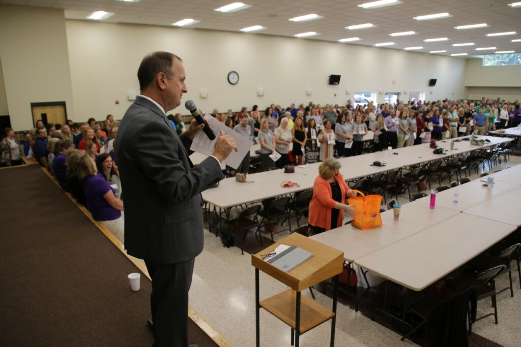 Dr. Daryl Hagan, diocesan superintendent of schools, explained rules of an ice-breaker game that Catholic educators played at the Aug. 2 back-to-school gathering.