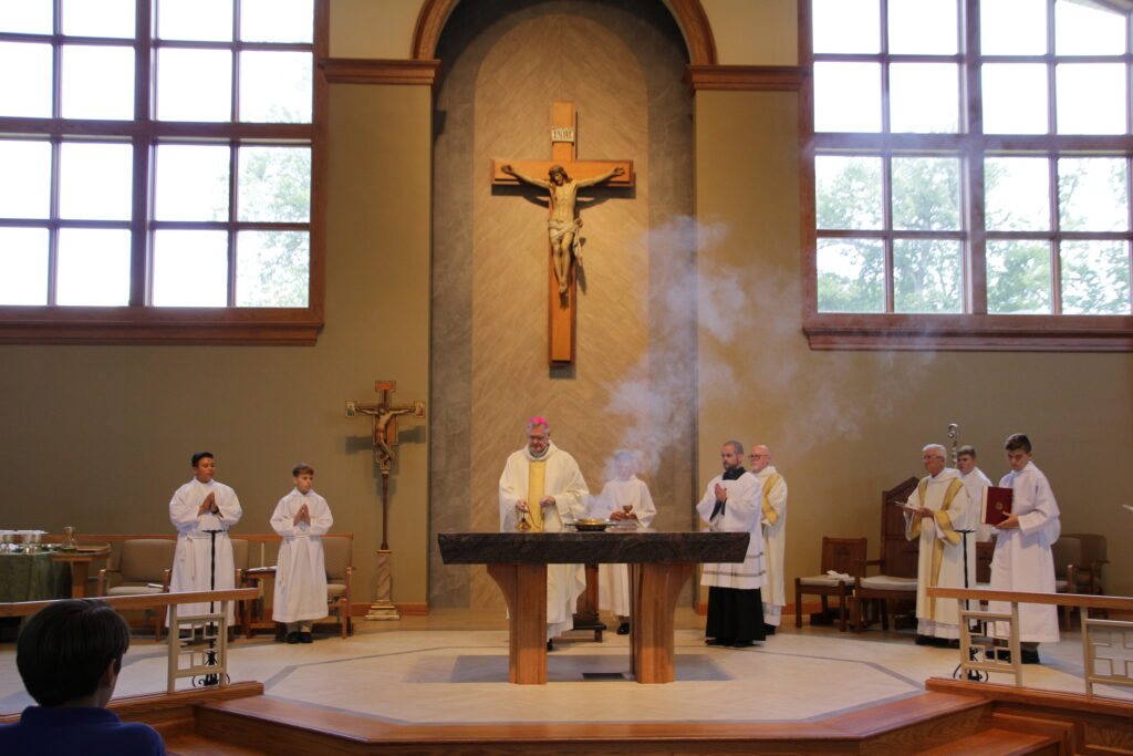 Bishop Joseph M. Siegel censes the new altar in St. John the Baptist Church in Newburgh as he dedicates it during Mass Sept. 23. Sitting on the altar is a brazier with incense. The Message photo by Tim Lilley