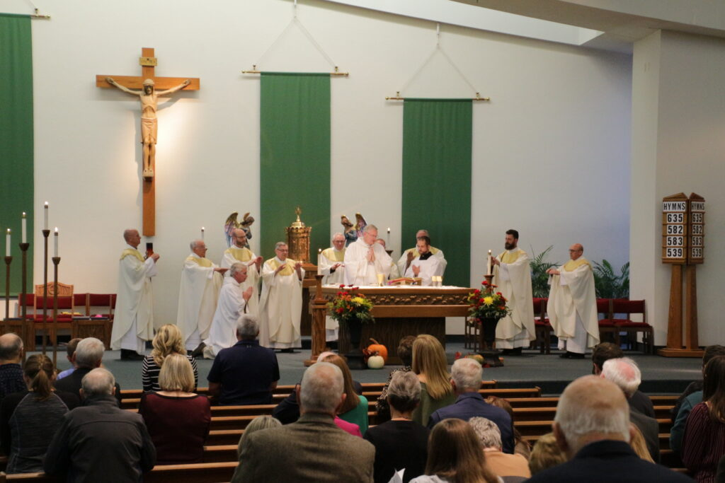 Bishop Joseph M. Siegel concelebrates Mass with nine priests of the Diocese of Evansville to open the 2019 diocesan Respect Life Celebration. Good Shepherd Parish in Evansville hosted the Oct. 17 event. The Message photo by Tim Lilley