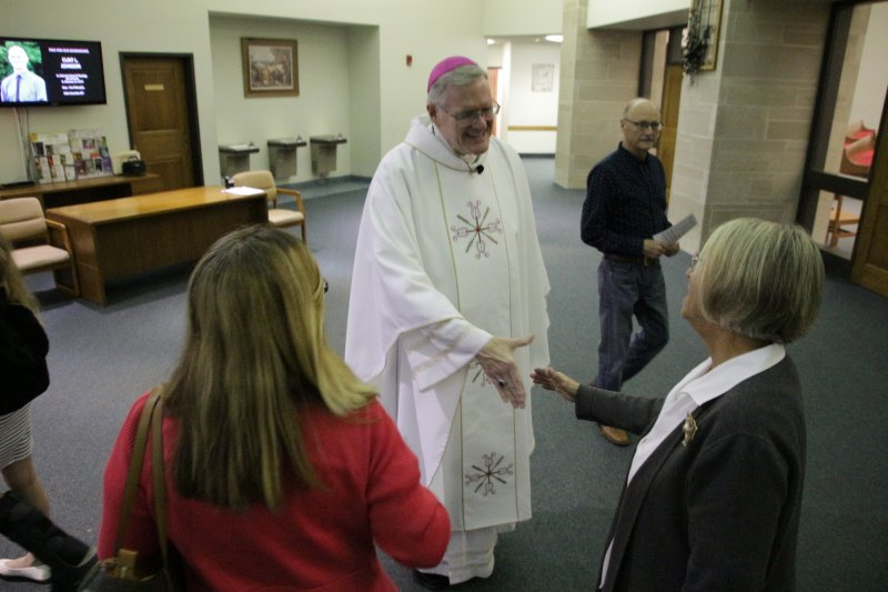 Bishop Siegel visits with Respect Life Celebration attendees following Mass at Good Shepherd Parish. The Message photo by Tim Lilley