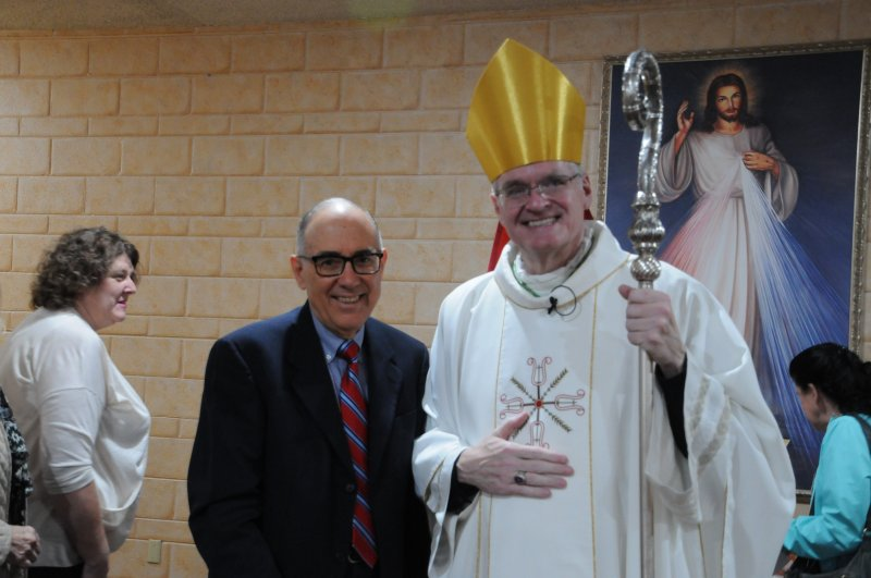 Dr. Peter A. Rosario, left, President of Southwest Indiana Guild of the Catholic Medical Association, and Bishop Joseph M. Siegel posed for a photo after the Oct. 29 Diocesan White Mass at St. Joseph Parish in Princeton. The Message photo by Megan Erbacher