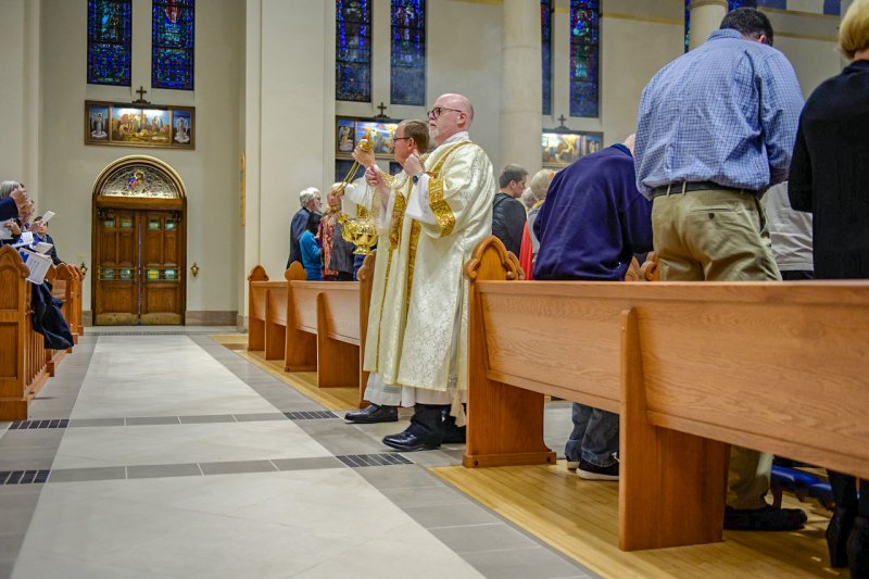 Deacons David Rice, left, of St. Benedict Cathedral Parish and Jay VanHoosier of St. John the Baptist Parish in Newburgh make their way throughout the cathedral, censing the cathedral and all those in attendance. The Message photo by Jay Hamlin
