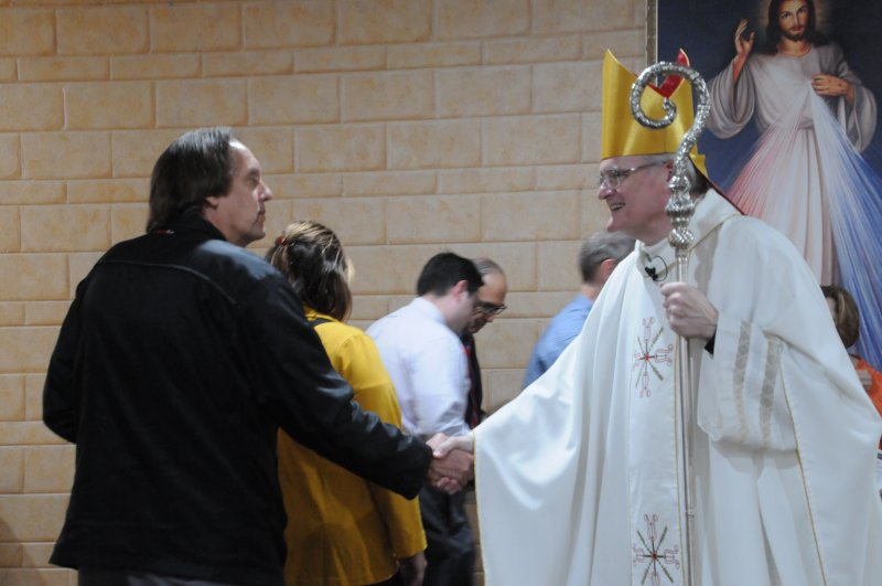 Bishop Joseph M. Siegel, right, greets people after this year's Diocesan White Mass. More than 60 people attended the Mass, which is celebrated annually on or near the Oct. 18 Feast of St. Luke, patron of healthcare professionals. The Message photo by Megan Erbacher