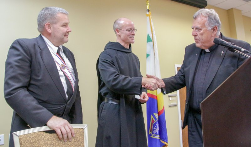 Benedictine Father Adrian Burke of St. Meinrad Archabbey in St. Meinrad, center, accepts $2,000 in donations from the Knights of Columbus during the Oct. 29 Clergy Appreciation Dinner in Huntingburg. Making the presentation are Mike Stone, left, Grand Knight of Jasper Council 1584, and Father John Boeglin, pastor of Holy Family Parish in Jasper and K of C Chaplain. The Message photo by Tim Lilley