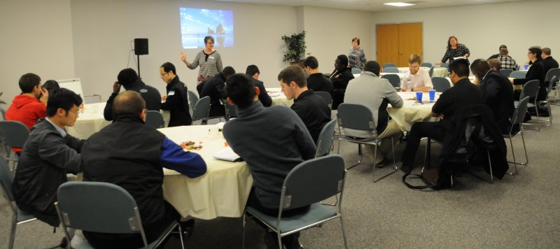 Saint Meinrad Seminary and School of Theology seminarians participate in a poverty simulation exercise at a Poverty Summit on Dec. 4 hosted by Catholic Charities and Potter's Wheel. The Message photo by Megan Erbacher