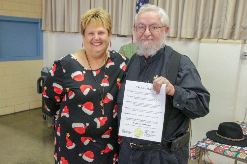 Deacon Thomas Lambert, right, stands with City of Boonville Clerk-Treasurer Tammy Boruff as he holds the proclamation Boruff read that designated Dec. 19, 2019, as Deacon Thomas Lambert Day in the city. The Message photo by Tim Lilley
