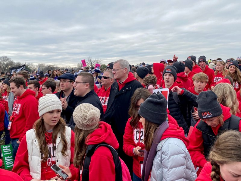 Bishop Joseph M. Siegel, center, joined our pilgrims for the Jan. 24 march. Standing in front of him in the dark coats are Diocese of Evansville seminarians Tyler Underhill, wearing a hat, and Keith Hart. Photo by Father Jason Gries, special to The Message