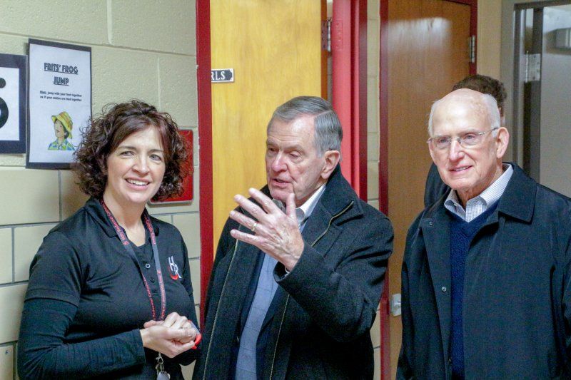 Jim Meuhlbauer, center, vice-chairman of Evansville's Koch Enterprises, Inc., asks Holy Redeemer School principal Andrea Dickel a question as he and Koch Enterprises, Inc. Chairman Bob Koch tour the school on Jan. 30. The Koch Foundation awarded a grant to Holy Redeemer to support Leader in Me training for the school's students and teachers. The Message photo by Tim Lilley