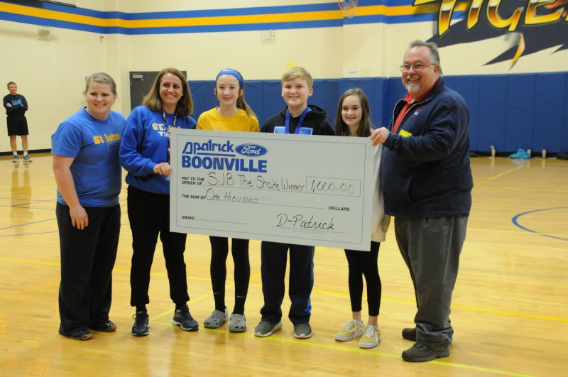 The winners of the first-ever SJB Shake were announced at a schoolwide assembly on Jan. 30. Pictured are: middle school science teacher Megan Wade, left; Principal Elizabeth Flatt; seventh-grader Abby Price, second place; sixth-grader Tyler Schmitt, first place; seventh-grader Marilyn Cox, third place; and Tony Toomy, D-Patrick Boonville Ford representative. The Message photo by Megan Erbacher