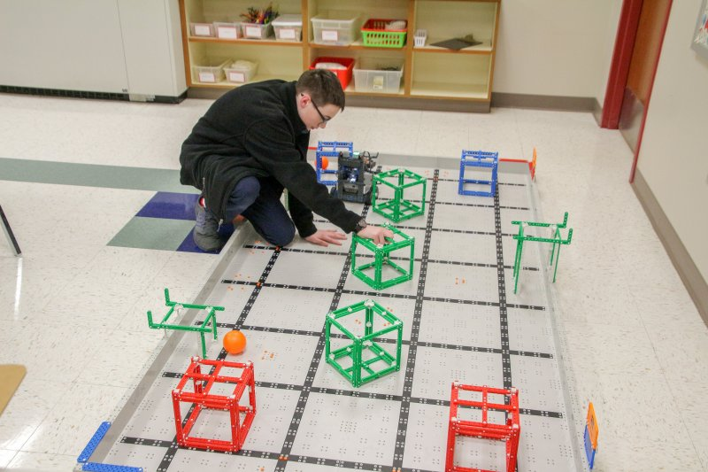 Holy Redeemer student seventh-grader Rylan Garrett demonstrates a robotics project during the Come and See event. The Message photos by Tim Lilley