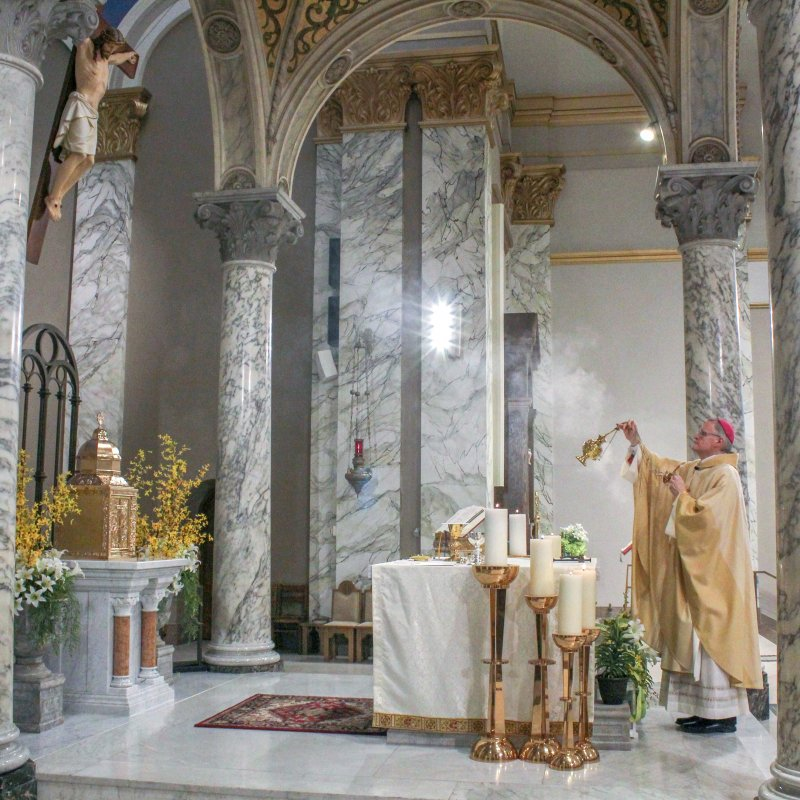 Bishop Joseph M. Siegel censes the altar and the gifts during the 9 a.m. Mass on Easter Sunday, April 12, at St. Benedict Cathedral.