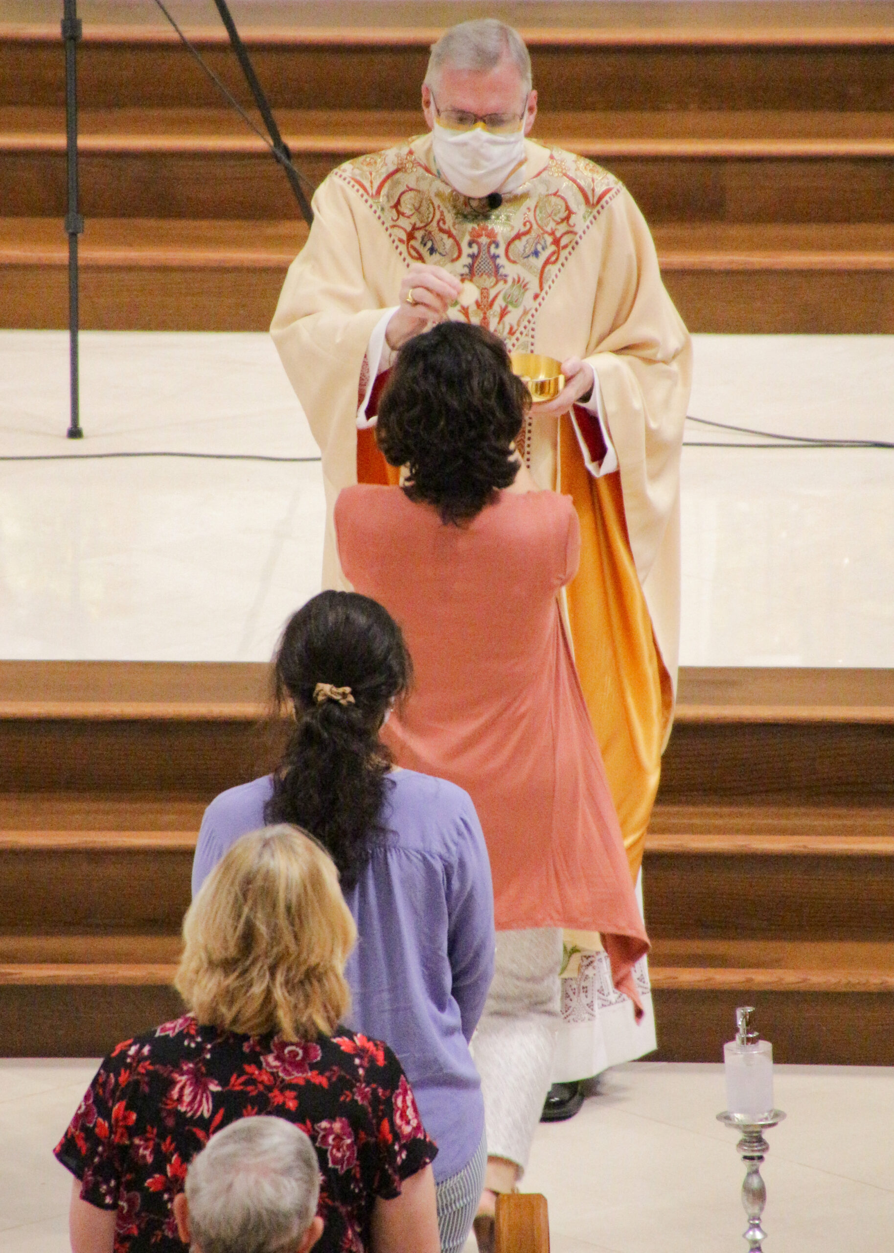 Parishes across the Diocese of Evansville resumed weekend Masses May 23-24. Bishop Joseph M. Siegel, shown wearing a face mask while distributing Communion, celebrated the 10:30 a.m. Mass on May 24 at St. Benedict Cathedral in Evansville. Photo special to The Message