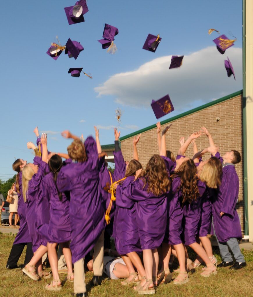 Members of Rivet's Class of 2020 toss their caps in the air after the June 12 Commencement Ceremony at Highland Woods Community Center.  The Message photo by Megan Erbacher