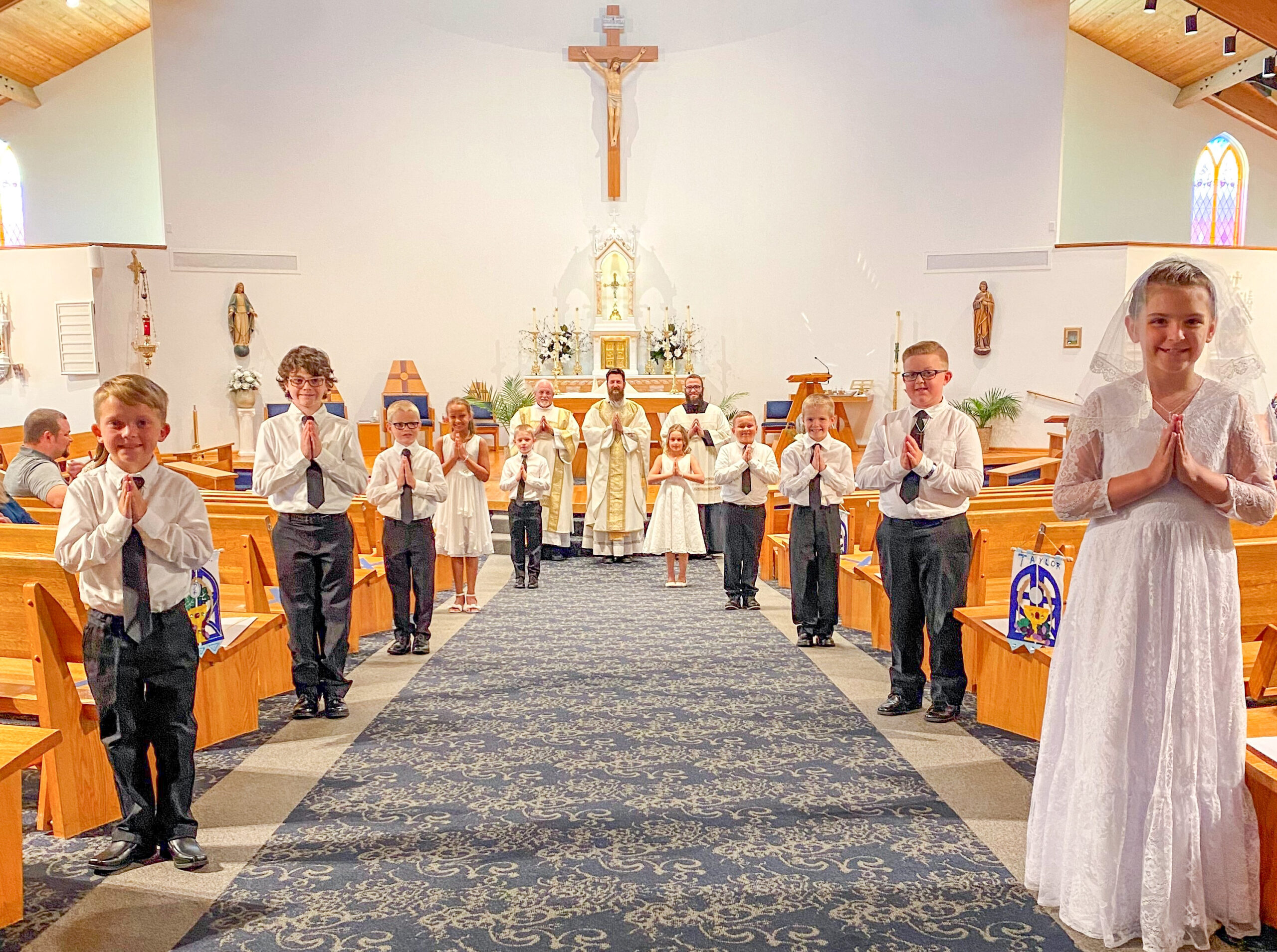 St. John the Evangelist Parish in Daylight celebrated First Communion on June 14 with social distancing – even during the group photo! Pictured are First Communicants Jase Young, left, Leo Van Hoy, Wyatt Mueth, Ava Kinder, Mason Gist, Lilly Crichfield, Jake Jenkins, Patrick Leslie, Taylor Rogge and Elizabeth Young. Standing in back are Deacon Richard Leibundguth, left, St. John the Evangelist Pastor Father Chris Forler and seminarian Caleb Scherzinger. Submitted photo courtesy of St. John the Evangelist Parish, Daylight