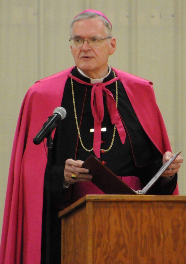 Bishop Joseph M. Siegel delivers a message to Rivet's graduating seniors June 12 at Highland Woods Community Center. The Message photo by Megan Erbacher