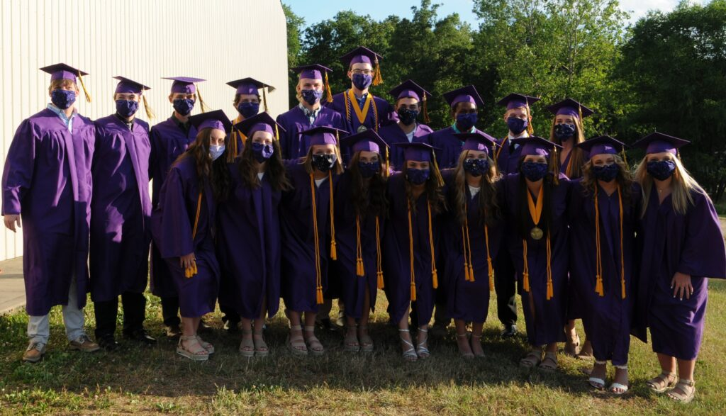 Members of Rivet's Class of 2020 pose after graduation with CDC recommended facemasks to help prevent the spread of the coronavirus. The Message photo by Megan Erbacher