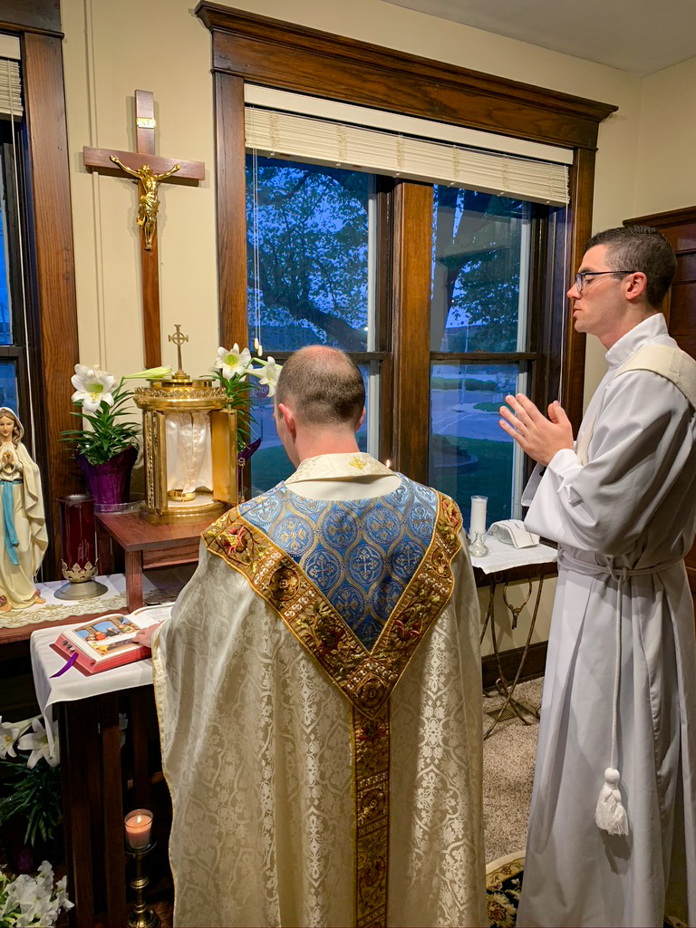 House Director Father Tyler Tenbarge and seminarian Deacon Garrett Braun celebrate Easter Sunday sunrise Mass in the House Chapel during the COVID-19 outbreak. Submitted photo courtesy of Father Tyler Tenbarge