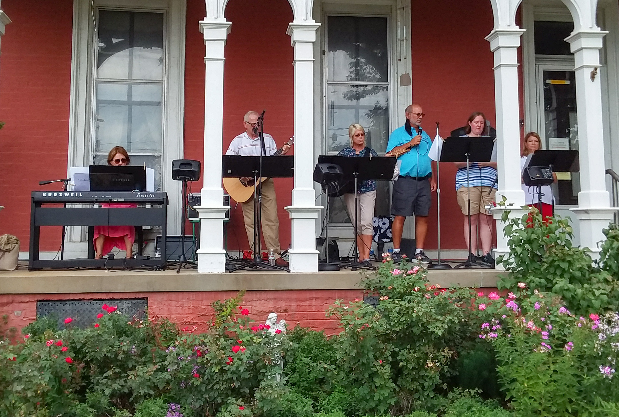 Evansville's All Saints Parish served close to 60 friends and neighbors around the St. Anthony campus with fresh produce during the Aug. 9 giveaway event. The All Saints Praise Band performed from the rectory porch during the giveaway. Submitted photos courtesy of All Saints Parish