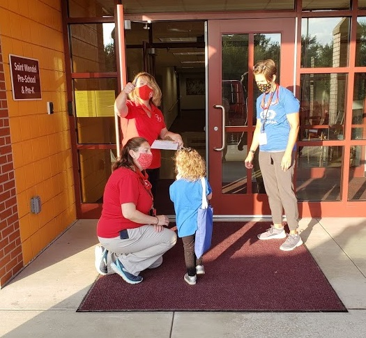 St. Wendel School principal Hallie Scheu welcomes students back to school on Aug. 5. Seventeen Catholic Diocese of Evansville schools returned to the classroom the week of Aug. 3, while the remainder of Catholic schools resumed the week of Aug. 10.  Submitted photo