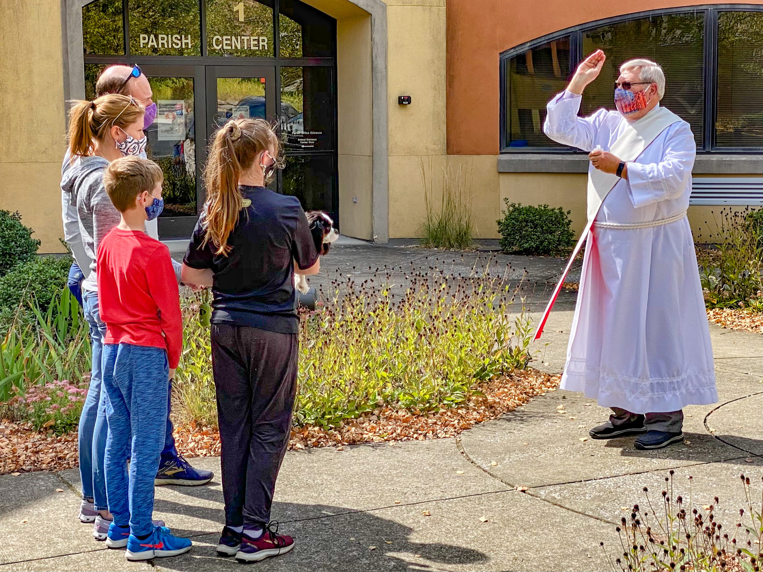 Deacon Tom Cervone of Evansville's Holy Redeemer Parish blesses animals outside the parish center on Oct. 3, the day before the Feast of St. Francis of Assisi. Deacon Tom blessed seven dogs and two cats. Submitted photo