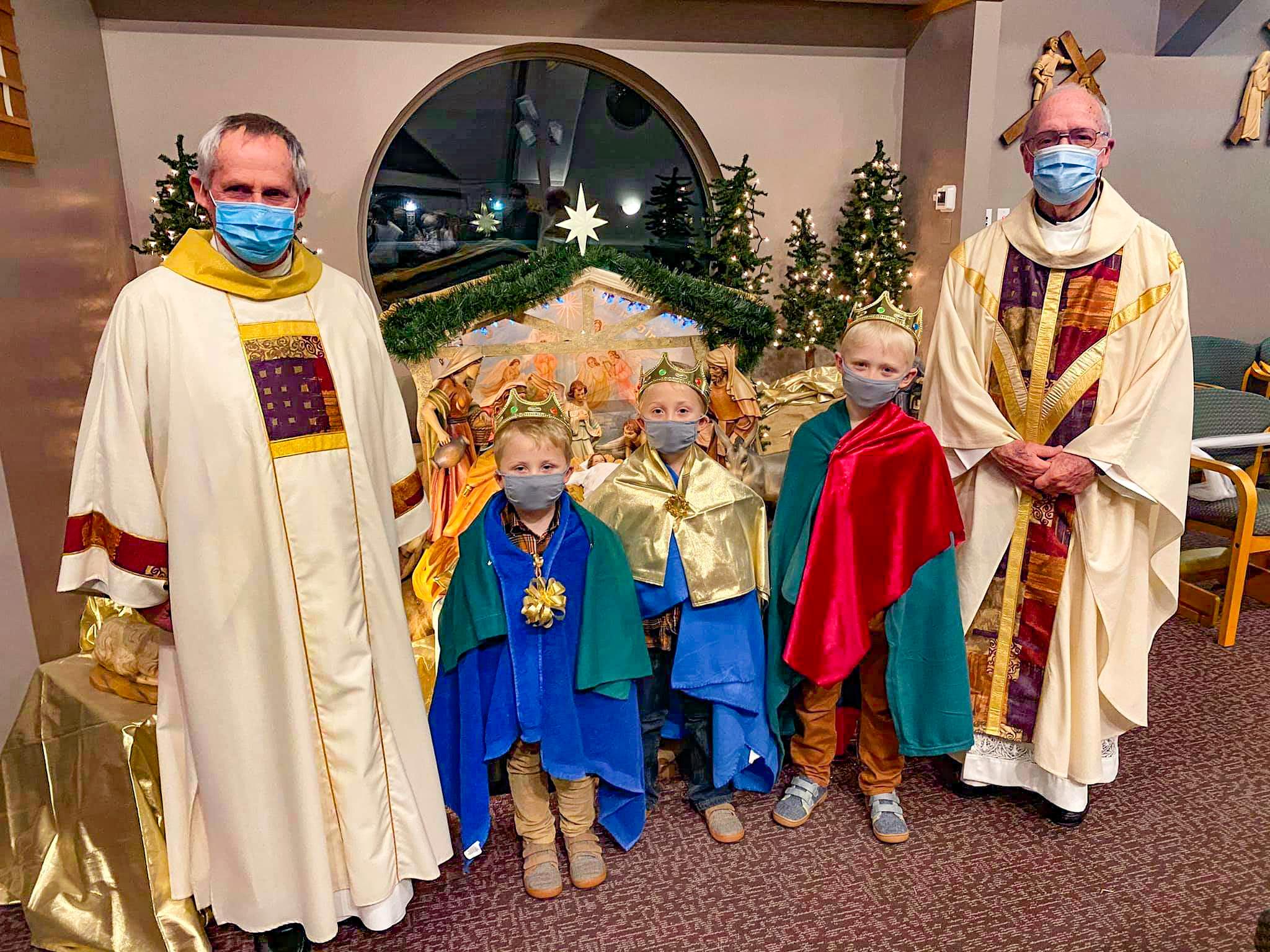 During the Epiphany Anticipatory Mass, Jan. 2 at St. Francis of Assisi Parish's St. Nicholas Church in Santa Claus, Liam, Parker and Preston Ward portrayed the three wise men who traveled from the east to present gifts to Jesus, the newborn King of the Jews. Shown with them are Deacon Jim Woebkenberg, left, and Father Donald Ackerman, who celebrated the Mass. Submitted photo