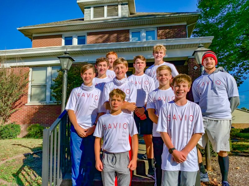 Diocese of Evansville Seminarian Bradley Gehlhausen, right, stands with some teenage members of Savio who gathered for a photo in front of the Father Deydier House of Discernment after a morning run in 2020. Submitted photo courtesy of Father Tyler Tenbarge