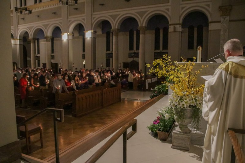 Those in attendance held candles during the Easter Proclamation. The Message photo by Tim Lilley