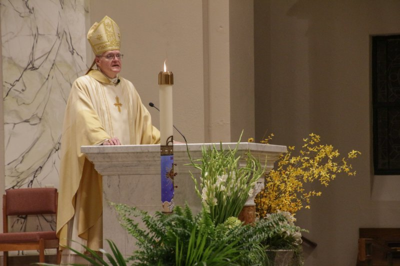 """In his homily, Bishop Siegel called the Resurrection """"the triumph of divine love."""" The Message photo by Tim Lilley"""