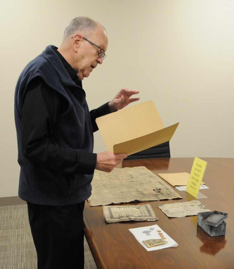 """Father Joseph """"Effie"""" Erbacher reads notes taken about the items found in the 1904 time capsule. The Message photo by Megan Erbacher"""